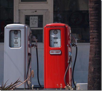 two-american-vintage-gas-pumps-in-a-very-old-gas-station-renee-anderson